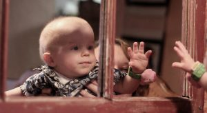 little boy looking at reflection