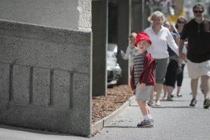 boy in red hat at beach
