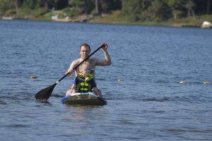dad son paddle board
