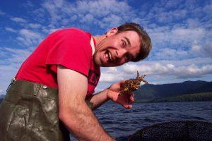 man holding shrimp in Ketchikan on boat