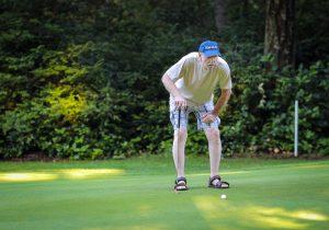 old man golfing