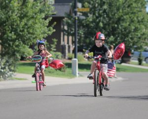 little boy in July 4 bike parade