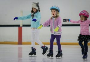 little girl balancing ice skating