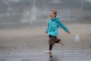 little girl running on beach
